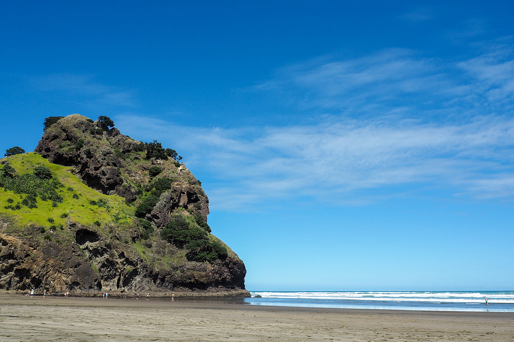 Lion Rock, a rocky hill shaped like a lions head that extends into the sea at Piha.